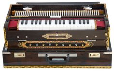 Amazon.com: MAHARAJA Calcutta Harmonium - 3 Reed, 9 Scale Changer - 3¾ Octave - With Coupler, Mahogany Color, with Book & Bag - Tuned to A440 (PDI-BGH): Musical Instruments