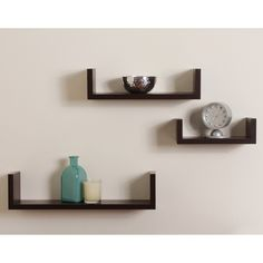 Danya B. Nesting Shelves 3 Pack in white laminate finish is the perfect accent for any living space and makes space utilization efficient. Perfect for displaying your favorite books, collectibles, photos, toys, awards, and decorative items, these shelves can be hung with the vertical sides up or down; according to the effect you want to create. With the vertical sides up, it is like having a built in bookend. Easy to install with no visible connectors or hardware. All hardware included.