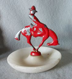 Art Deco cowboy on a horse (metal) mounted on an alabaster bowl.  Ashtray or trinket dish.