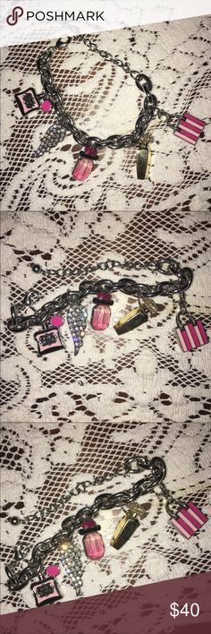Victoria's Secret charm bracelet 10 inch long collectible Victoria's Secret charm bracelet with 5 charms! Angel wings, a gold bottle of perfume, noir tease bottle of perfume, a pink bottle of perfume, and a pink shopping bag! Super cute and never worn just don't have the original box. Silver plated link that adjusts to fit your wrist size. Victoria's Secret Jewelry Bracelets
