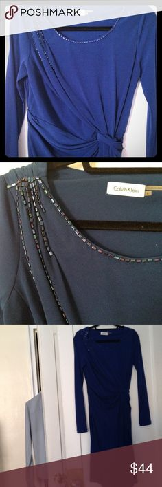 Calvin Klein Dress with Gem Embellishment Royal blue long sleeve royal blue dress with gems along the neckline and sleeve gems and on the right shoulder. Dress has ruched details around the waist. Dress is a size 6 (as per tag) but would fit much better someone who wears size 8. Calvin Klein Dresses Midi