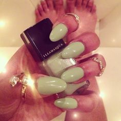 polished green rounded nails