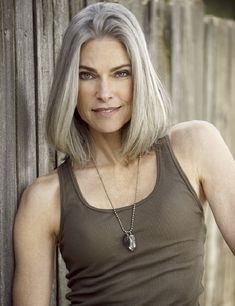 Roxanne Gould. Older, gray and toned. She has nicer arms than many women my age!
