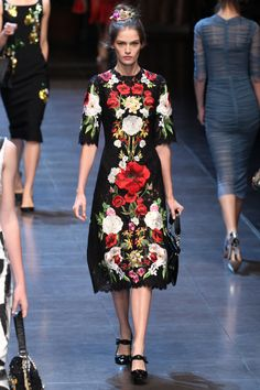 Body con dresses came out in black lace and ruched chiffon, but were accented with vibrant red-based florals or cheeky metallic embroidered fruit. The widow has gone glamorously sexy for Spring.    - HarpersBAZAAR.com