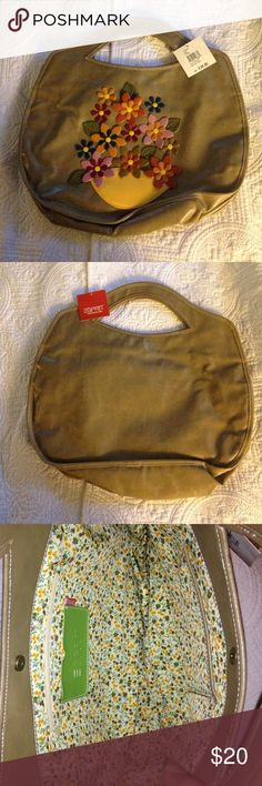 ESpirit handbag ! This is a brand new bag with tags on it. The color is a shiny green with a bouquet of flowers on the front. Inside and outside is clean. Esprit Bags