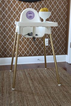 IKEA hack: antilop highchair. Very budget friendly and doesn't scream baby. Bonus: This blog has tons of DIY inspiration and tutorials. (Dwellings By DeVore)