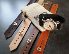 These adjustable watch straps are made from full grain veg tanned 4 oz. leather. Standard widths are 18mm, 20mm, or 22mm. We will cut other widths as well as custom orders. The strap has a very clean look and comes in a variety of colors. First picture from left to right: natural, tan, oxblood, black, brown, and dark brown. The natural will develop a beautiful patina over time. Adjustable by moving the button stud to any of the 8 sizes each 0.25 inches apart.  Standard strap length is 10…