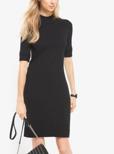 Cropped sleeves and a mock neckline detail this effortlessly chic dress, knit…