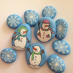 snowmen and snow flake rock painting