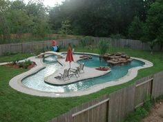A Beach Entry Pool   29 Amazing Backyards That Will Blow Your Kids' Minds... Can't even handle this awesome pool