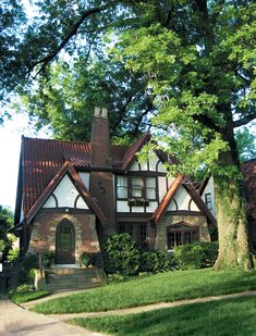 """Built in 1932 and designed by architect C. J. Winnes, Oak House is our Craftsman interpretation of a classic Tudor. We named it """"Oak House"""" in honor of the monarch oak (at right) that shelters it. We still have the original blueprints, as well as a photo of Winnes'  cinder-block office, circa 1927. His own house is about a mile away. The chimney pots were made by the Wheatley pottery company and are pictured in their 1927 catalog (see next photo)  Sadly, in March of 2011 we had to cut down…"""