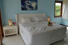 Another room with kingsize bed, dressing room, SAT-TV, balcony with hammocks, minibar and bathroom with hot water shower, jacuzzi and toilet. Towels are prepared for you and will be changed whenever you need. The room gets cleaned every day by our wonderful employees.