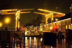 What is the name of this bridge in Amsterdam? #trivia #quiz #pictureoftheday #quizquest #thursday #amsterdam #bridge #canal #water #lights