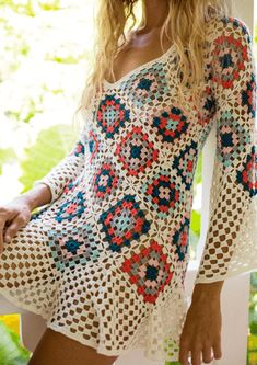 Our hand-crocheted mini dress is any boho babe's Coachella dream! This form fitting mini dress with a multicolor geometric pattern and long bell sleeves crea