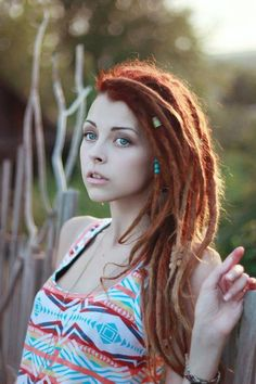 Pretty red dreads. I want dreads, they're so pretty.