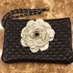 Murka black flower clutch. Gorgeous clutch. Chain is substantial and very good quality. Never used and purchased new. Murka Bags Clutches & Wristlets