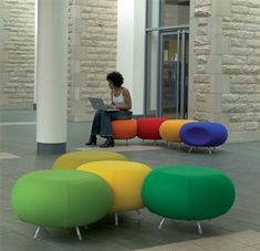 modular ottomans.  See the indentation on the purply-blue one?  They snug right into each other.  Would be great for Teens or just scattered among the stacks as a resting place for people, bags, books.