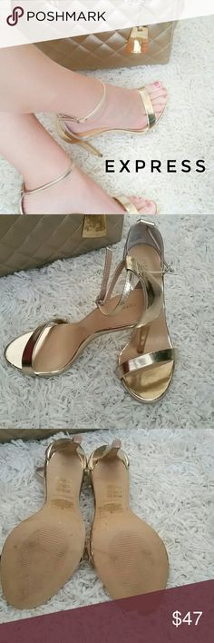 Express high heels Beautiful gold high heels from express. Very lightweight. Slightly worn. Look amazing with a pair of boyfriend jeans, if you want to dress down. Also looks amazing with a dress on a night out with the ladies. Express Shoes Heels