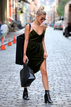 It's official: we've got outfit envy. Hailey Baldwin's draped velvet dress and black boot combo has got us reaching for our winter wardrobe, while her bare legs and gold jewellery have got pining for summer. Transitional outfit perfection.