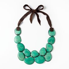 Mira Necklace - teal ($72) - Sustainably harvested Tagua beads from Ecuador are assembled by artisans into a bold necklace with a locally sourced leather tie.
