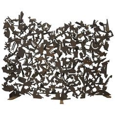 Mid-Century Brutalist Iron Petroglyph Sculpture Fireplace Screen Paul Evans Era | From a unique collection of antique and modern sculptures at https://www.1stdibs.com/furniture/decorative-objects/sculptures/