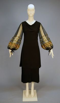 CREPE and NET COCKTAIL DRESS with NEEDLEPOINT, Black consisting of dress having net bodice with balloon sleeve decorated with needlepoint in green, brown and taupe, tying at the cuff,. 1930s Fashion, Timeless Fashion, Vintage Fashion, Timeless Elegance, Victorian Fashion, Fashion Fashion, Vintage Outfits, Vintage Gowns, Vintage Clothing
