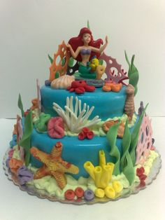 A Little Mermaid cake! Love the starfish, coral, sponges, and just so much detail! :)