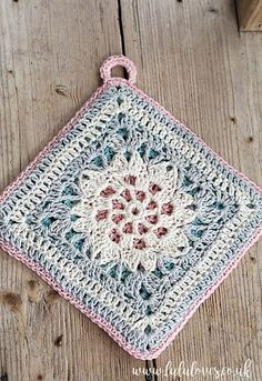[Free Pattern] This Gorgeous Pastel Spring Potholder Will Look Great In Your Kitchen! - http://www.dailycrochet.com/free-pattern-this-gorgeous-pastel-spring-potholder-will-look-great-in-your-kitchen/