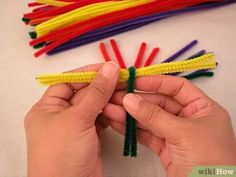 How to Make a St Brigid's Cross with Pipe Cleaners. This article will be telling you how to make a St Brigid's cross out of pipe cleaners. St Brigid is one of Ireland's patron Saints and she made a cross out of rushes to protect her from. Brigid's Cross, Cross Art, St Brigid Cross, Saint Patricks Day Art, Pagan Witchcraft, Spring Art, Patron Saints, Book Of Shadows, Arts And Crafts