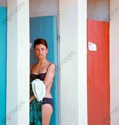 Women / Fashion / Ladies' fashion, bikini, View of a young woman in bikini standing at the door of the changing rooms of the town's . Ladies Fashion, Womens Fashion, Changing Room, Akg, Retro Color, Young Women, 1960s, Rooms, Colour