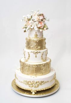 Another magnificent five tier Ron Ben Israel wedding cake with bold gold rococo appliqués.