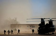 Marines from the 2nd Force Reconnaissance Company evacuate a CH-47 Chinook during an urban environment warfare exercise April 18, 2013, at the Playas Training and Research Center in Playas, N.M. Exercise Angel Thunder comprises 19 countries and is the world's largest international personnel recovery exercise. (U.S. Air Force photo/Senior Airman Andrew Lee)