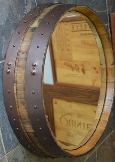 Our Napa Valley wine barrel mirror is created from the top of a wine barrel and features original hand finished metal bands. This is the perfect