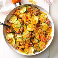 400 Cals Zucchini & Sausage Stovetop Casserole Recipe -Gather zucchini from your garden or farm stand and start cooking. My family goes wild for this wholesome casserole. We like our zucchini grated, not sliced. Sausage Casserole, Casserole Recipes, Zucchini Casserole, Sausage Quiche, Rice Casserole, Mozzarella, Pork Recipes, Cooking Recipes, Recipies