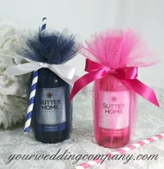"""Miniature wine bottle bridal shower or wedding favor wrapping idea using 15"""" wide, scalloped edged tulle circles, satin ribbon and striped straws. Item FS018 at www.yourweddingcompany.com #wedding #bridal #shower #favor #wrapping #tulle #wine #design"""