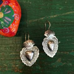 """These Mexican sterling silver earrings are hand made near Mexico City. Heart shaped, made of .925 silver, are medium size about 1"""" long. Unique and pretty. Simple and informal. 1 pair left! state of o"""