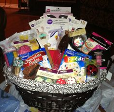 All Things Baking gift basket for a bride-to-be.... Makes a fun and impressive Bridal Shower gift! (hint: place a cupcake carrying tray at the bottom of the basket for added height and an extra surprise!!)