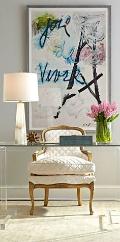 home office decorating ideas with bold art and glamorous armchair