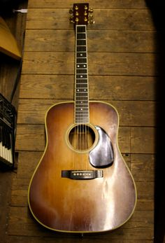 Martin d28.  As vintage as a guitar gets.