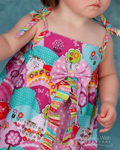 Four Way Baby Dress - from Simple to Wow! 0-24 months | YouCanMakeThis.com