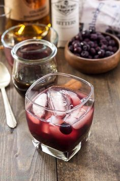 This classic drink gets a fresh and modern update as a cinnamon blueberry old fashioned. The bitters combined with cinnamon simple syrup and the sweet and tangy splash of blueberries makes the cinnamon blueberry old fashioned the perfect drink for dad. Holiday Drinks, Party Drinks, Cocktail Drinks, Fun Drinks, Yummy Drinks, Cocktail Recipes, Holiday Recipes, Alcoholic Drinks, Beverages