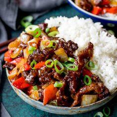 Close up of crispy orange beef with rice.