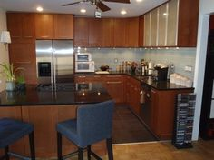 """Again, this is what I DON'T WANT.  The cabinets are too overwhelming for the small space, even with the glass cabinets added in. The wood is too uniform and """"polished-looking"""" for me. IKEA kitchen Adel Medium Brown in Hoboken contemporary-kitchen"""