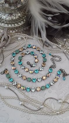 TRANQUIL SEAS incorporates all the Colors of a Picture perfect Coastline. Turquoise, Sparkling Golden Shadow, Glowing Pacific Opal, and Crystal Clear Lt. Swarovski Jewelry, Crystal Jewelry, Crystal Necklace, Swarovski Crystals, Rhinestone Jewelry, Fine Jewelry, Jewelry Making, Jewelry Art, Vintage Jewelry