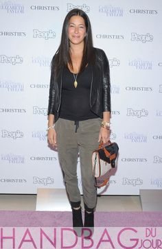 Rebecca-Minkoff-attends-People-Magazine-and-Christie's-Elizabeth-Taylor-Collection-preview-event-at-Christie's-on-December-1,-2011-in-New-York-City-carrying-her-Rivington-convertible-clutch
