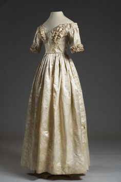 Silk brocade dress, 1842. The skirt is set onto the bodice in flat pleats, with the skirt slightly fuller in the back. Elizabeth Mary Lesesne Blamyer wore this dress at her wedding to Henry Wigfall (1821-1858) on February 24, 1842 at Saint Paul's Church.