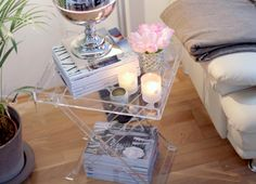 Tray Table.  I don't know if Lucite is a trend and on its way out, but I like this little set up.   I think that the structure and modern quality of the Lucite stand and the orderly stacking of the magazines tones down the girly-ness enough for Amazing Husband to get on board.