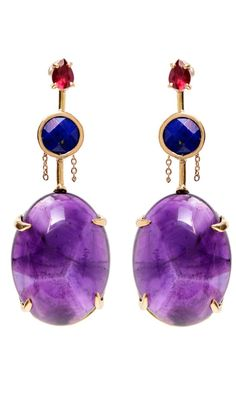 A stunning pair of gemstone earrings in gold. By Unhada jewelry.