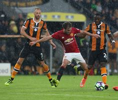 Juan Mata of Manchester United in action with Adama Diomande and David Meyler of…