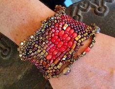 Bracelet, freeform peyote weave, seed beads of gold and rainbow metallic, coral…